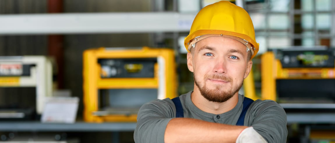 Field service engineer with blue eyes and yellow hard hat