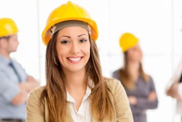 Female field service engineer in yellow hard hat working for Dutch Recruitment company in Spain